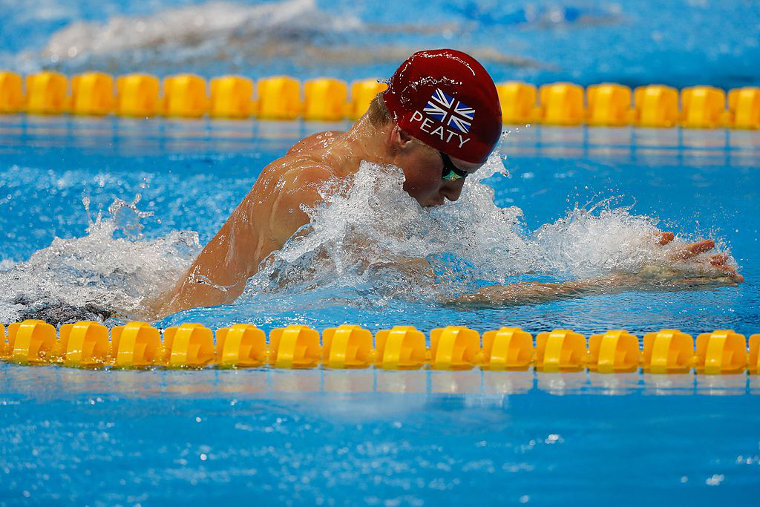 Adam Peaty of Great Britain is the olympic record holder of 100 m breakstroke with 57,13 he swam in Rio 2016. Peaty also holds the world record 56,88 of the same discipline. He swam the WR in the 2019 World Champs.